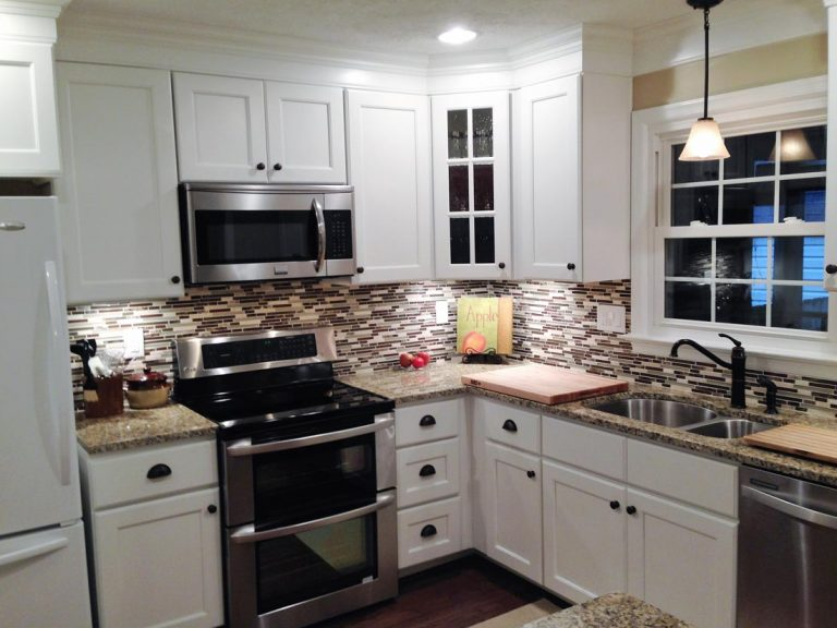 remodeled kitchen with accent lighting, decorative wall splash, wood finish kitchen flooring